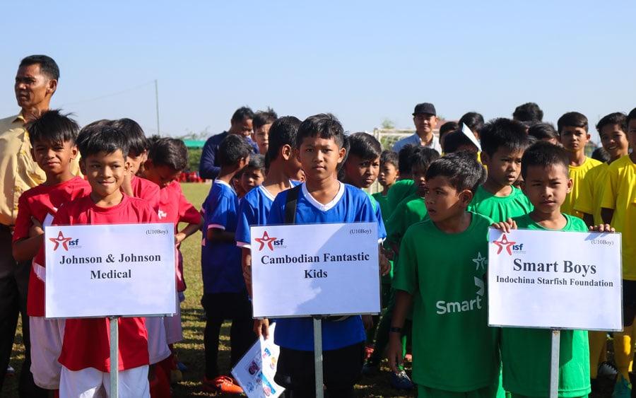 Johnson & Johnson Medical Sponsored Football Team eagerly awaits play at the Ian Thompson Memorial - ISF Boys' Tournament